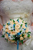 The bodice bridesmaid dresses and bridal bouquet close-up. — Stock Photo