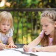 Two little kid making school homework — Stock Photo #42165553