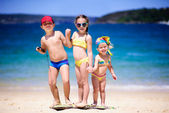Group of kids on a beach — Stock Photo