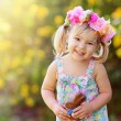 Cute easter child  girl eat chocolate bunny outdoor — Stock Photo #43451525