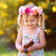 Cute easter child  girl eat chocolate bunny outdoor — Stock Photo #43451693