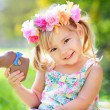 Cute easter girl with chocolate bunny — Stock Photo #43451939