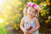 Cute easter child  girl eat chocolate bunny outdoor — Stock Photo
