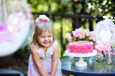 Little girl celebrate Happy Birthday Party with rose outdoor — Stock Photo