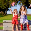 Little girls waving American flag — Foto de Stock