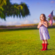 Little girl waving American flag — ストック写真