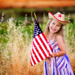 Little girl waving American flag — Stock Photo #46061795