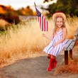 Little girl waving American flag — Photo #46061815