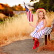 Little girl waving American flag — Стоковое фото