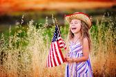 Little girl waving American flag — Stock Photo