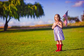 Little girl waving American flag — Foto Stock