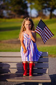 Little girl waving American flag — Stock Photo