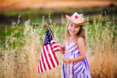 Little girl waving American flag — Photo