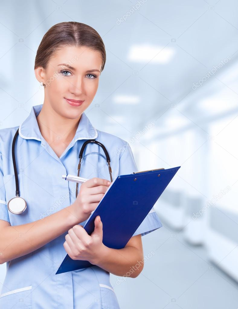Young medical doctor woman in the office with stethoscope and clipboard — Stock Photo #14021462