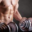 重りを持ち上げる — ストック写真