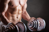 Lifting weights — Stockfoto