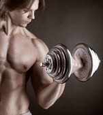 Exercising with dumbbell — Stock Photo