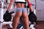 Sexiga vackra röv på gym — Stockfoto