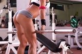 Sexy young girl at gym — Stock Photo