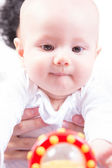 A baby reaches for toy — Stock Photo