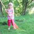 Little girl working in garden — Stock Video