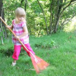 Little girl working in garden - Stock Photo