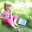 Little girl with laptop - Stock Photo