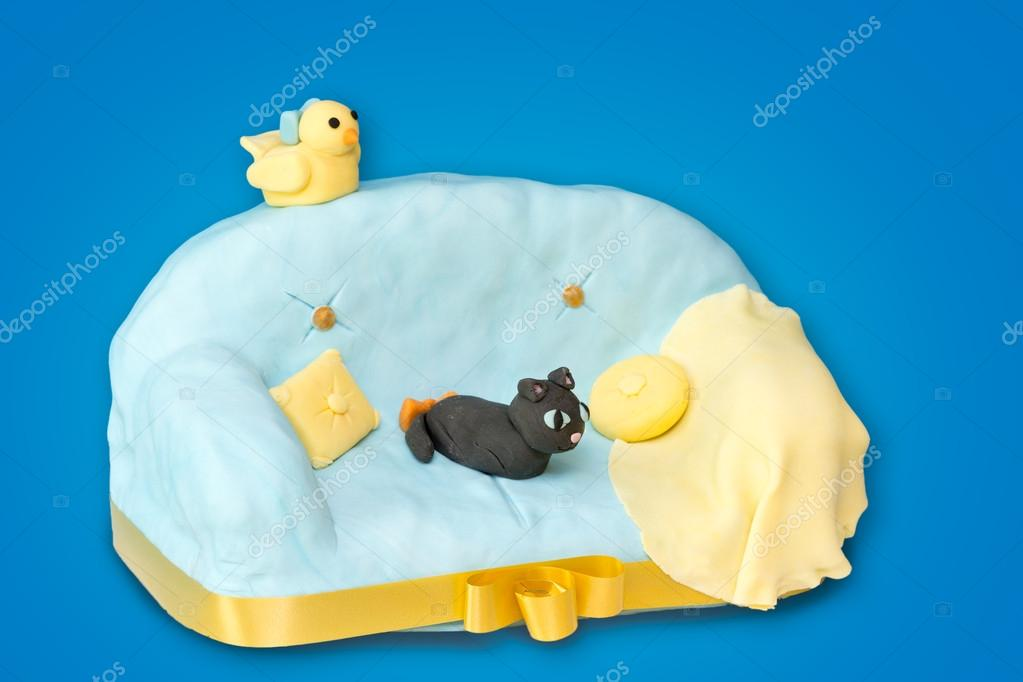 Fondant Cake with sofa shape on blue background — Stock Photo #13886036