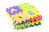 Alfabe puzzle parçaları — Stok fotoğraf