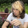 Stock Photo: Teenage boy smoking electronic cigarette