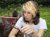 Teenage boy smoking an electronic cigarette — Stock Photo