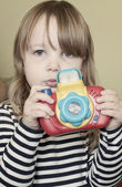 Girl with toy camera — Foto Stock