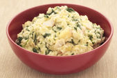 Risotto with haddock, leeks and spinach — Stock Photo