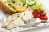 Baked fish fillet, tomatoes, potato and salad — Photo