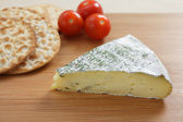 Herbed brie and crackers — Stock Photo
