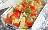 Shredded chicken and pepper slices — Stock Photo