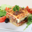 Moussaka and salad - Stock Photo
