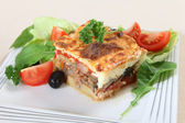 Moussaka and salad — Stockfoto