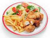 Fish nuggets fries and salad — Stock Photo
