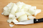 Diced onion with a kitchen knife — Stock Photo