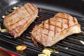Grilling steak — Stock Photo
