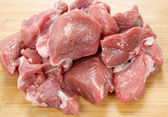 Cubed lamb meat on a board — Stock Photo