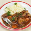 Oxtail stew dinner with fork — Stock Photo