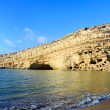 Cliffs at Matala on Crete - Stock Photo