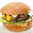 Homemade burger in bun - Stock Photo