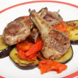 Grilled lamb chops on salsa — Stock Photo