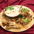 Stock Photo: Jeerchicken with cucumber raita