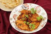 Kashmiri chicken and pappadums — Stock Photo