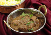 Beef rogan josh in a a balti dish — Stock Photo