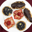 Fruit tarts and eclairs — Stock Photo